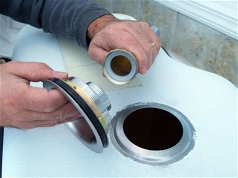 installing kitchen sink drain how to install a kitchen sink bob vila