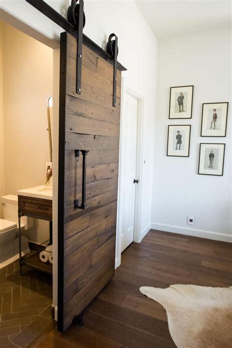 barn door ideas for bathroom reclaimed wood barn door gets things rolling in bathroom hgtv