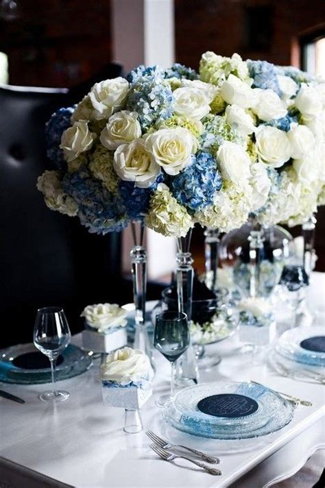 and white centerpieces centerpieces with white roses blue hydrangea and