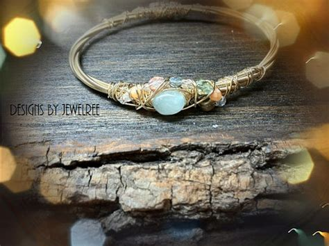 how to make jewelry out of guitar strings recycled guitar string bracelet adorned with by