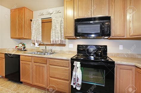 black kitchen cabinets with black appliances oak kitchen cabinets with black appliances oak kitchen