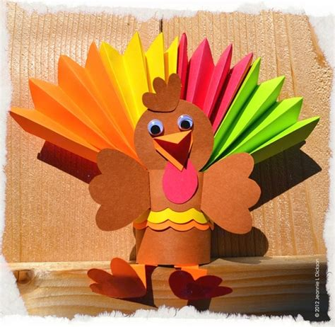 turkey toilet paper roll craft folded colored paper roll of toilet paper cut in half
