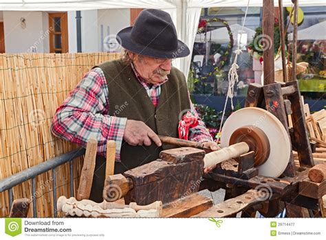 artisan woodworking an artisan working the wood with an antique lathe