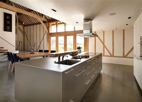 Farmhouse Home Designs 004 thatched barn bulthaup kitchen architecture homeadore