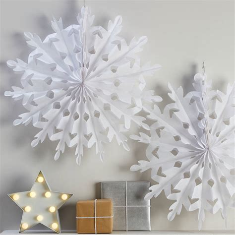paper snowflake decorations two white hanging snowflake decorations by