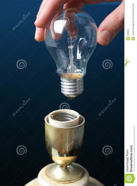 putting lights on a timer putting a light bulb in a l royalty free stock