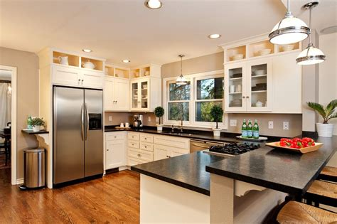 Kitchen Designs With Black Cabinets stove in peninsula kitchen traditional with wood floors