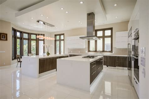Large Kitchens With Islands stainless steel appliances and two islands with prep area