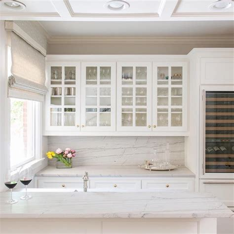 kitchen cabinets glass front glass front kitchen cabinets with gold knobs