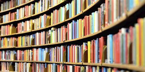 picture of books in library book shelf alumni