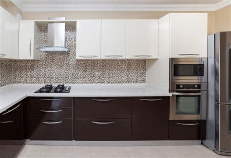 white and brown kitchen designs white kitchen cabinets that give an illusion of spaciousness