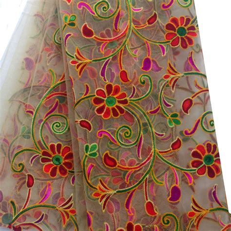 how to embroider on fabric beige net fabric with multicolour kutch embroidery
