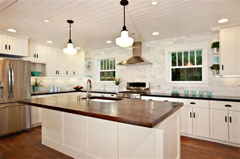 white kitchen wood island white kitchen with wood island carrara backsplash black granite