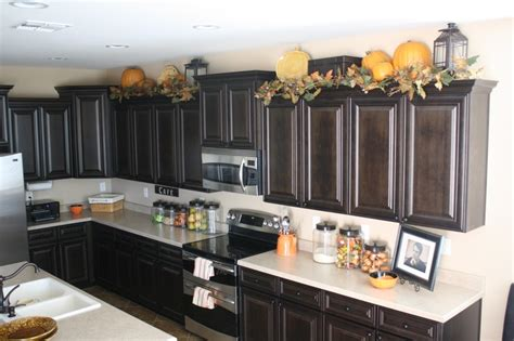 ideas for decorating top of kitchen cabinets lanterns on top of kitchen cabinets decor ideas