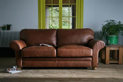 curved arm sofa the curved arm leather sofa by indigo furniture