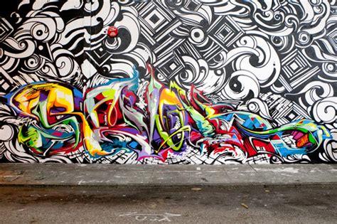 spray paint wall graffiti artist reyes steel revok spray paint a