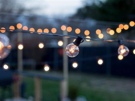 diy string lights how to hang outdoor string lights from diy posts hgtv