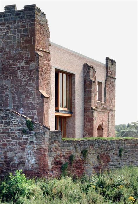 contemporary house inserted into crumbling castle ruins urbanist