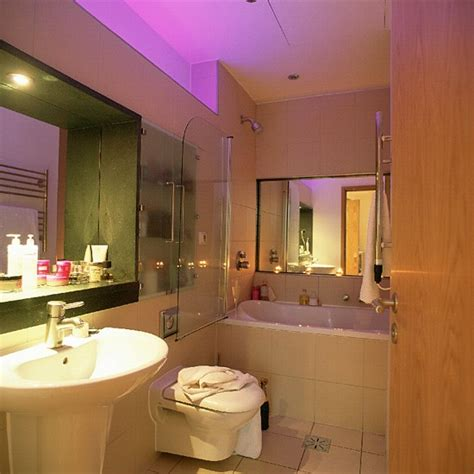 bathroom space saving ideas small bathroom with white suite and mirrors housetohome