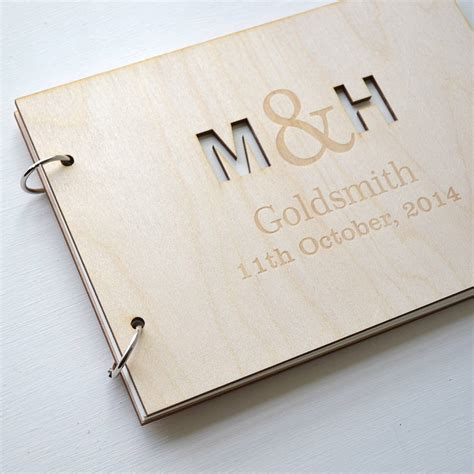 picture guest book personalised initials guest book by clouds and currents