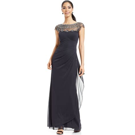 beaded illusion gown xscape cap sleeve illusion beaded gown in gray charcoal