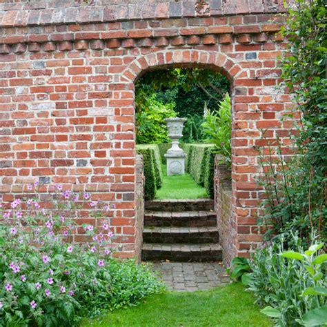 secret garden wall patio courtyard ideas on courtyards brick