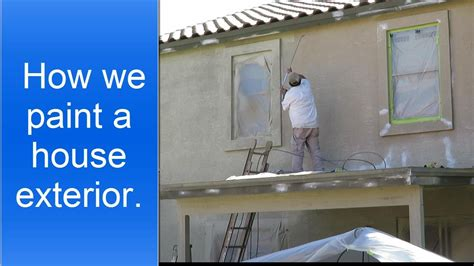 spray painting house painting a house exterior using an airless sprayer to