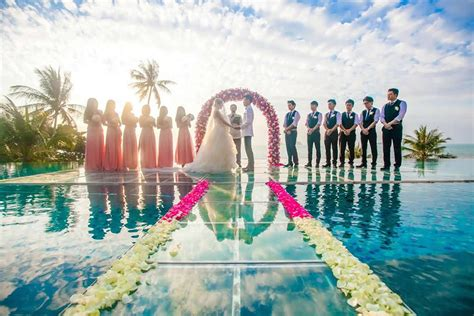 Bali Infinity Pool over water wedding ceremony at conrad koh samui extravaganzi