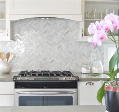 herringbone tile backsplash 25 best ideas about herringbone backsplash on