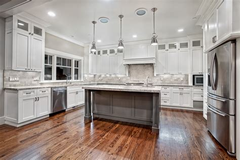 granite for white kitchen cabinets macavoy modern white kitchen griffin custom cabinets