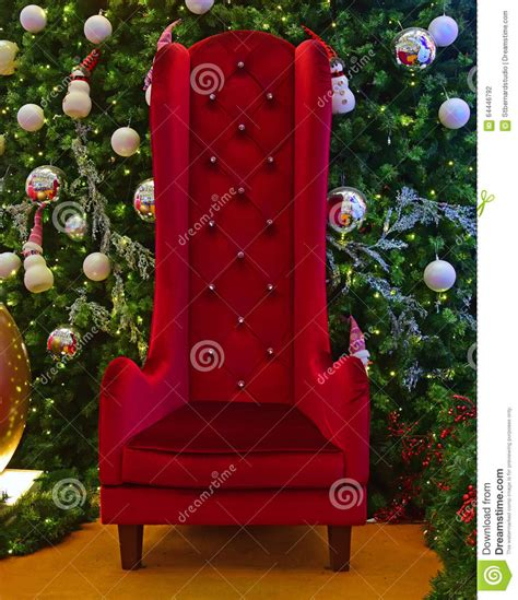 large santa large chair for santa claus with green tree
