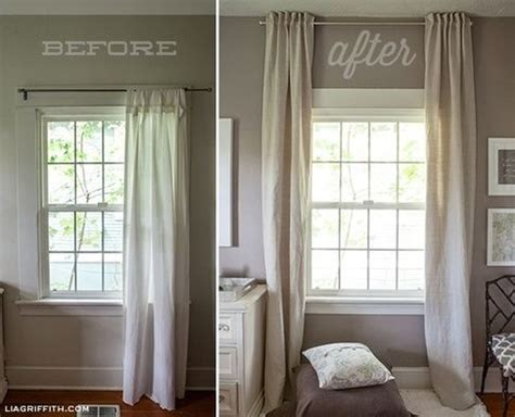 how low should curtains hang hang curtains up to the ceiling to make a low ceiling look