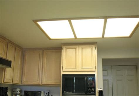 replace fluorescent light fixture in kitchen 33 best images about light on brushed nickel