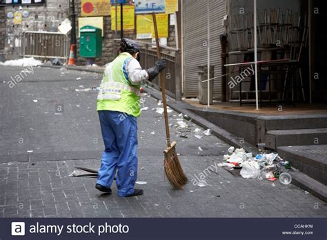st cleaner cleaner brushing streets with broom early