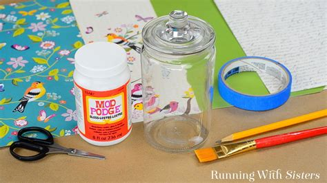how to decoupage glass jars how to decoupage a glass jar with mod podge running with