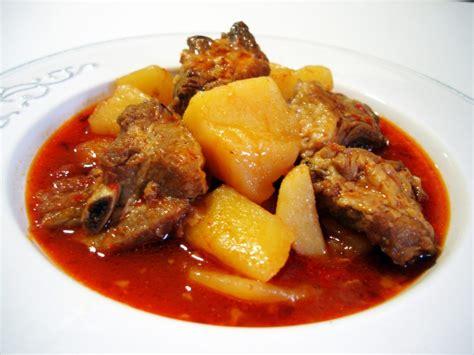 como cocinar costilla de cerdo patatas con costillas un delicioso guiso casero tradicional