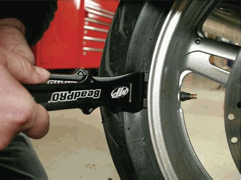 breaking the bead on a tire beadpro tire bead breaker and lever tool set by motion pro