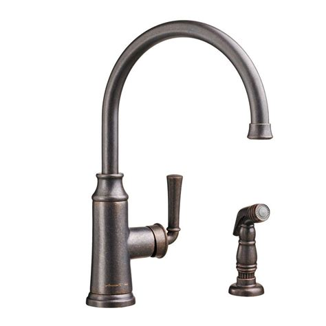 bronze faucets for kitchen american standard portsmouth single handle standard kitchen faucet with side sprayer in