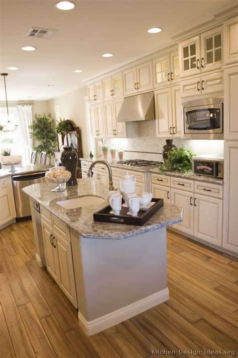 white kitchen cabinets with island antique white kitchen with wood floors and an island sink