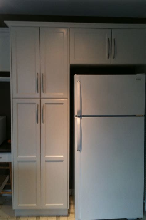spray painting unfinished cabinets cabinet repainting to paint or restain raelistic artistic