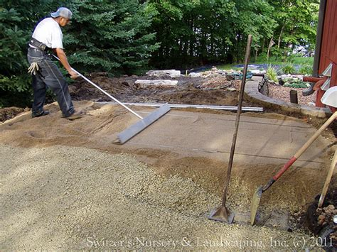 leveling patio pavers privacy pergola and paver walk during installation of