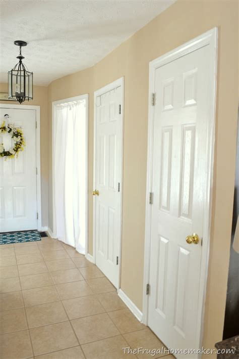 behr paint color nutty beige entryway before and after beige to greige with behr paint