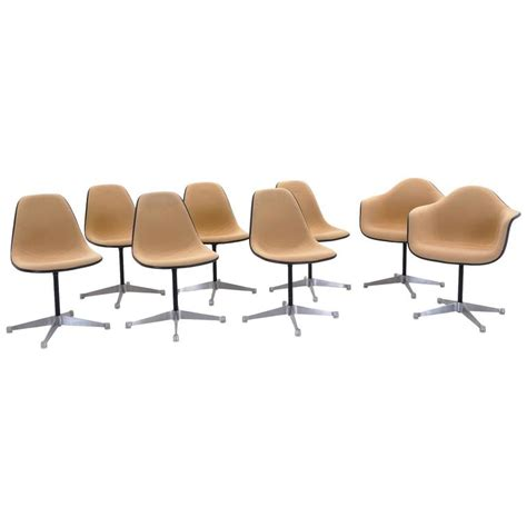 eames swivel chair set of eight upholstered eames swivel dining chairs two