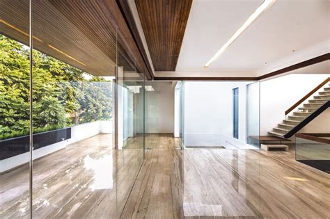 glass wall design a sleek modern home with indian sensibilities and an