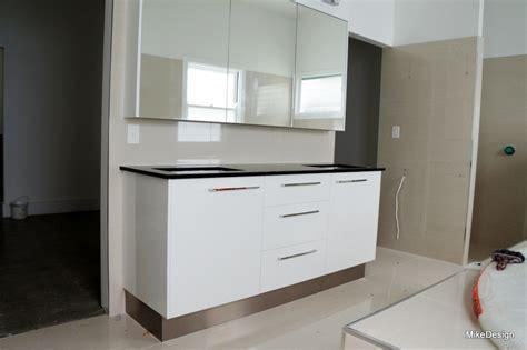 Home Design Board bathroom vanity with white gloss melamine board and black