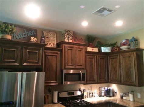 above kitchen cabinet decor ideas best 25 above cabinet decor ideas on