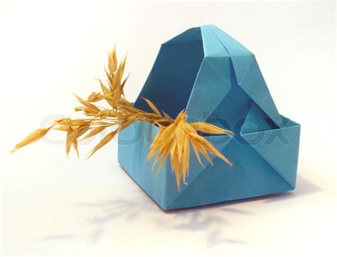 origami figure origami figure of blue basket with ears stock photo