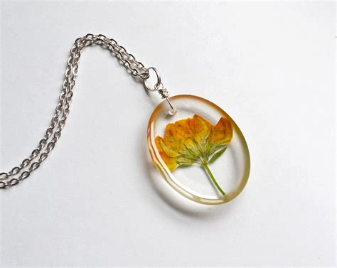 how to make pressed flower resin jewelry pressed flower necklace real flowers in clear resin yellow
