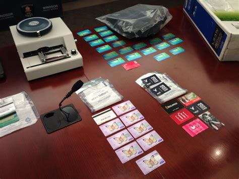 how to make a counterfeit credit card four charged with fraud after credit card lab