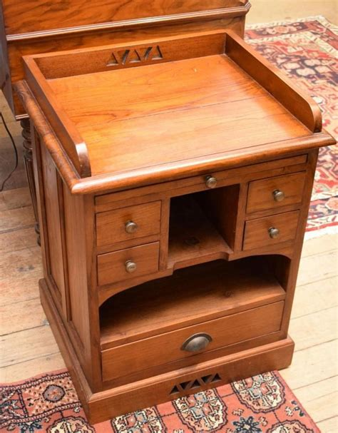 small wooden desk a small wooden writing desk with drawers